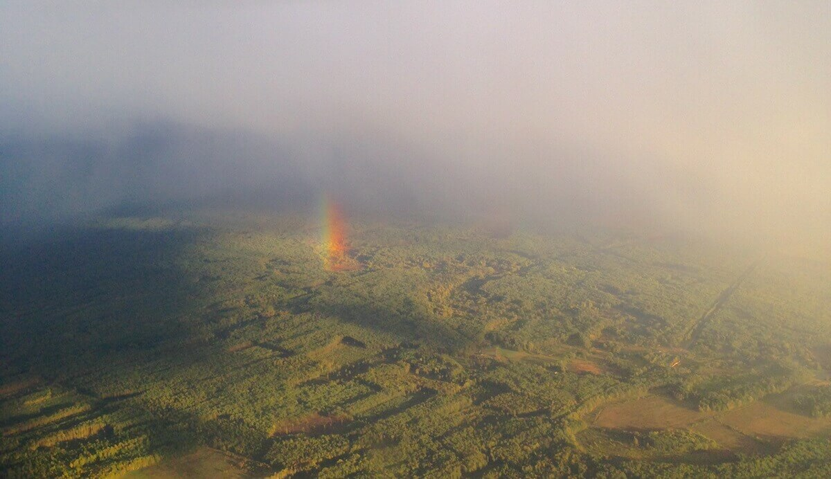 sky rainbow from a plane